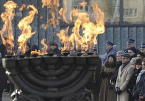 People attend a ceremony at the Warsaw Ghetto Uprising memorial in Warsaw, Poland
