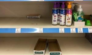 Almost empty supermarket shelves