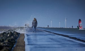 Walkers, windsurfers and wind turbines brave the gusts of Storm Gareth at West Kirby, Wirral, on 12 March 2019.