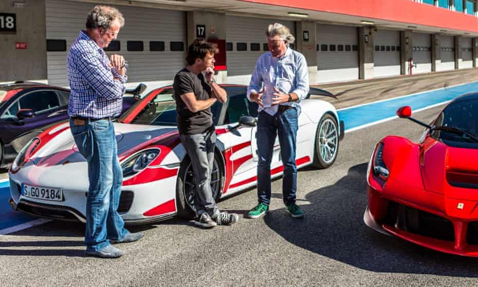 Stonewash denim required … the trio at the racetrack with more alienatingly expensive cars.