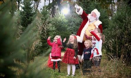Lance Skapura poses for Christmas photo with children.