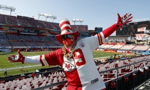 A Chiefs fan behind cutouts of fans in Raymond James Stadium