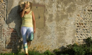 A model leans against the wall in flower leggings