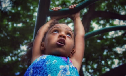 Girl on climbing frame