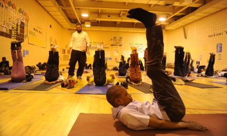 Students at Robert W Coleman elementary school participate in breathing exercises during the Holistic Me after-school program.