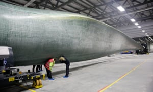 workers at a Siemens plant in Hull perform quality control checks on a turbine blade.