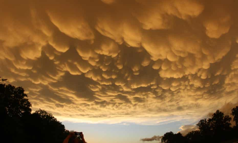 Yellow-tinged 'mammatus' clouds form a textured sky in advance of a storm in Oklahoma, US.