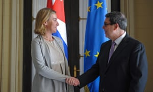 Federica Mogherini shakes hands with Cuba's Bruno Rodriguez at the Foreign Affairs Ministry in Havana, on Friday.