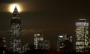 A supermoon rises over Frankfurt's finance district.