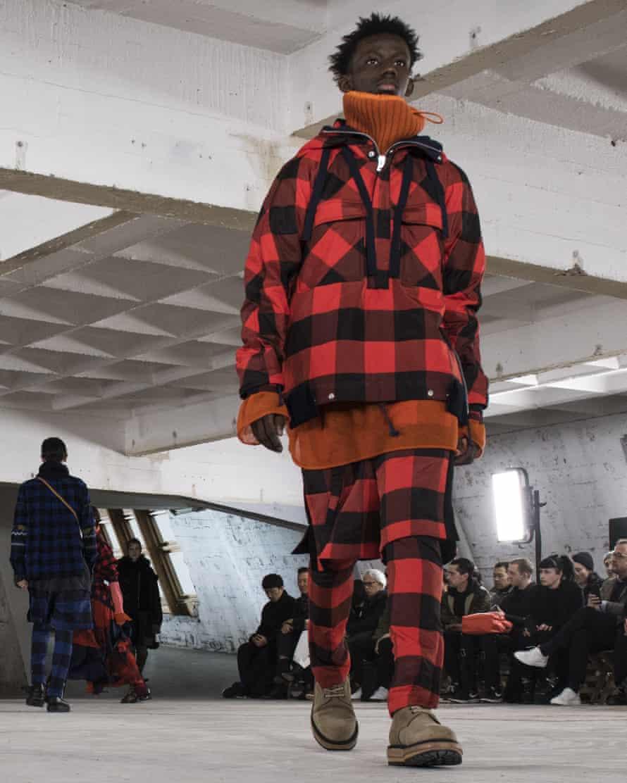 A model walks the runway during the Sacai Menswear show, Paris.