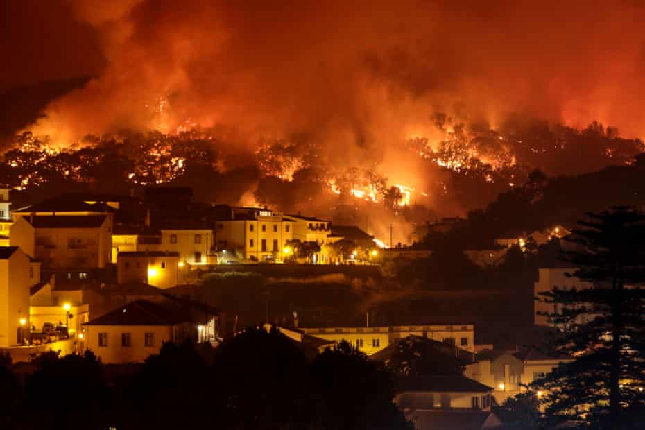 A forest fire burns on a hill in Monchique, Portugal, August 2018