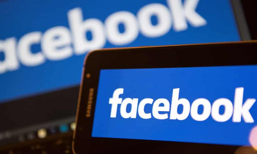 Facebook logo on phone and laptop