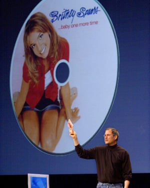 Apple Computers Inc. chief executive Steve Jobs holds up a CD of pop singer Britney Spears during Apple's World Wide Developer Conference in San Jose, Calif.,