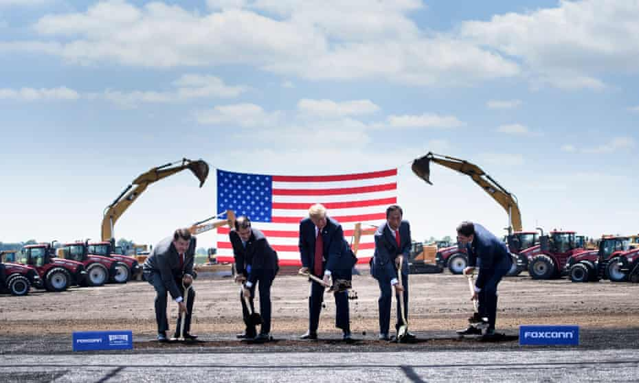 Wisconsin G=governor Scott Walker (second left), US President Donald Trump, Foxconn chairman Terry Gou (second right) and speaker of the House Paul Ryan (right) participate in a groundbreaking for Wisconsin's new Foxconn facility.