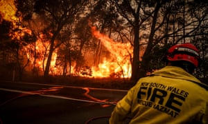 Fire and Rescue personnel run from a blaze near homes on the outskirts of Bilpin in New South Wales.