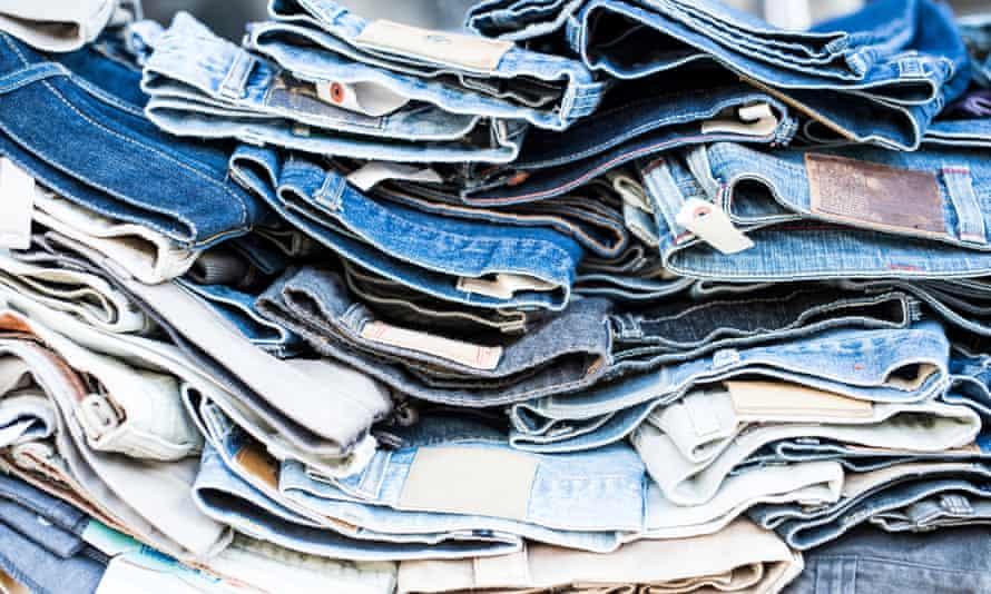 Stack of denim jeans.