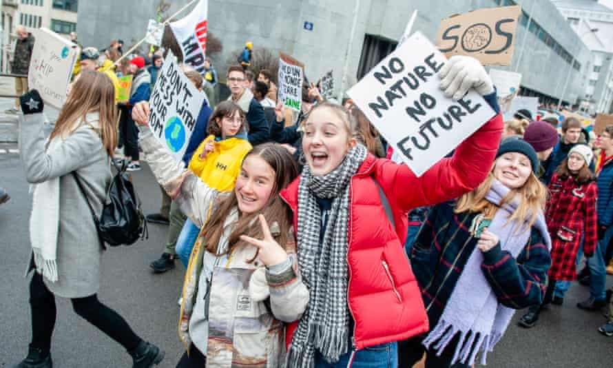 Students hold placards while shouting slogans during the demonstration in Brussels, 31 January.