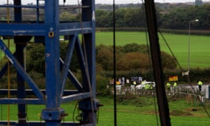 Anti-fracking protesters are seen on the edge of the site where shale gas developer Cuadrilla Resources have started fracking for gas.