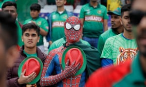 Bangladesh fans stand during their national anthem before the match against Australia at Trent Bridge.