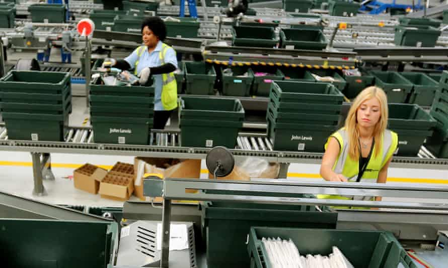 Young workers in a John Lewis warehouse
