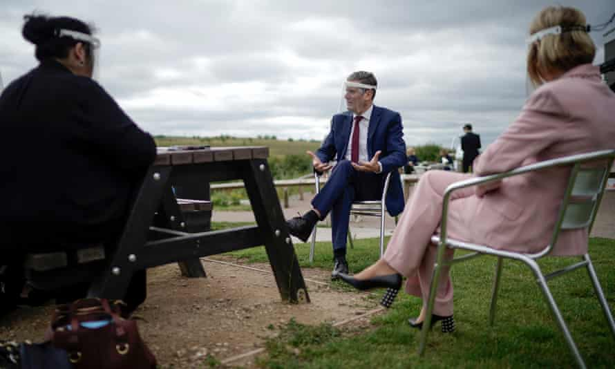 Labour Party leader, Sir Keir Starmer, wears a face visor during talks with care home workers and family members of residents during a visit to Cafe 1899 in Gedling Country Park on July 16, 2020 in Nottingham, England.