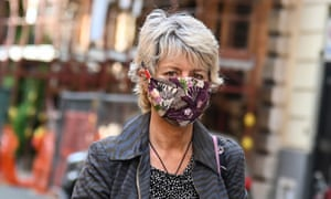 A woman wearing a homemade protective face mask in Rome