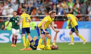 Emil Forsberg and Ola Toivonen of Sweden celebrate at the final whistle.