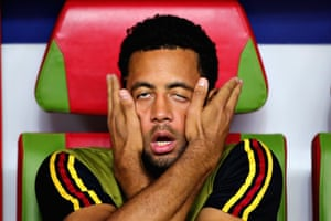 Mousa Dembele of Belgium is captured in a bizarre moment on the substitutes' bench in their quarter-final against Brazil.