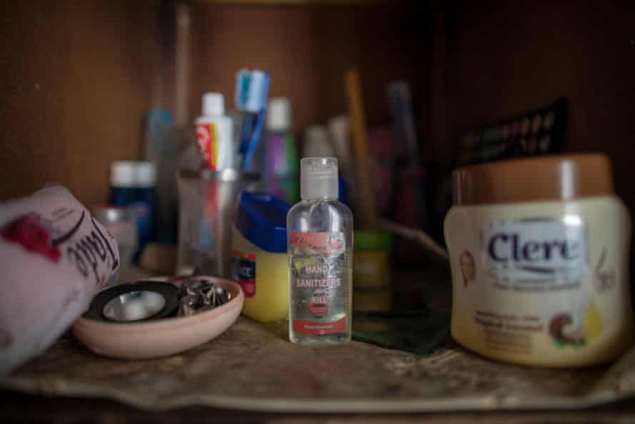 Mupombwi's hand sanitiser in her wardrobe at home