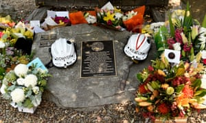 The helmets of volunteer firefighters Andrew O'Dwyer and Geoffrey Keaton at a memorial at the Horsley Park Rural Fire Brigade. They were in a truck convoy near the town of Buxton when a tree fell into their path, prompting the vehicle to roll off the road, with both men dying at the scene.