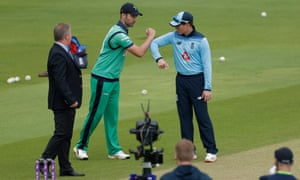 The two captains greet each other for the toss.