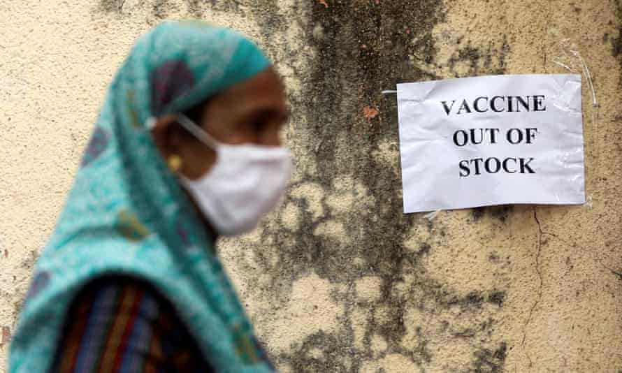 A notice about the shortage of coronavirus vaccine supplies is seen at a vaccination centre, in Mumbai.
