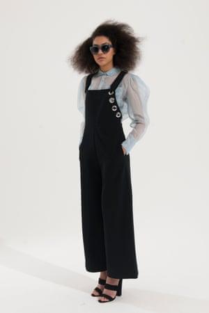 pale blue long sleeved sheer shirt, Stories, black dungarees, Mango, black high heeled mules ,large dark grey framed glasses Michael Kors