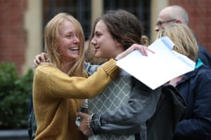 Students celebrate their A Level results at Brighton College in East Sussex.