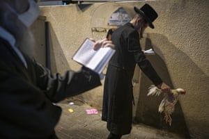 An ultra-Orthodox Jewish man holds a chicken as part of the Kaparot ritual in Bnei Brak.