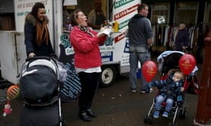 Child with Labour balloons in Royton, Oldham