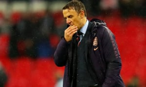 Phil Neville looks downcast after the defeat to Germany