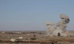 Smoke rises after an attack by Bashar al-Assad's forces in Syria's south-west Daraa province.