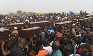 Pall bearers carrying the coffins of people killed during clashes between cattle herders and farmers earlier this month in Benue.