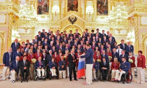 Russia's President Vladimir Putin, front centre, meets the national Paralympic team in Moscow's Kremlin in September 2012 after they returned from London after taking part in the Paralympic Games.