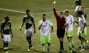 Clint Dempsey rips up referee Daniel Radford's notebook in the US Open Cup match against Portland.