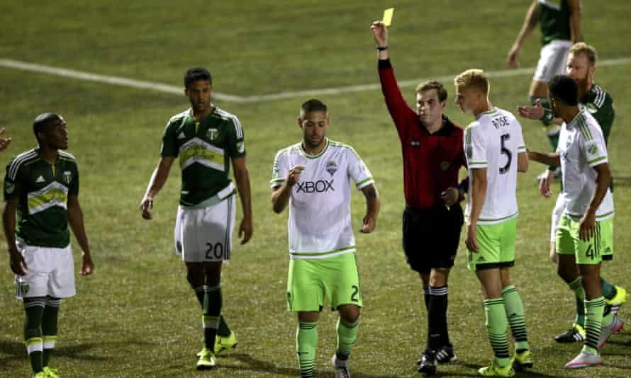 Dempsey rips up referee Daniel Radford's notebook.