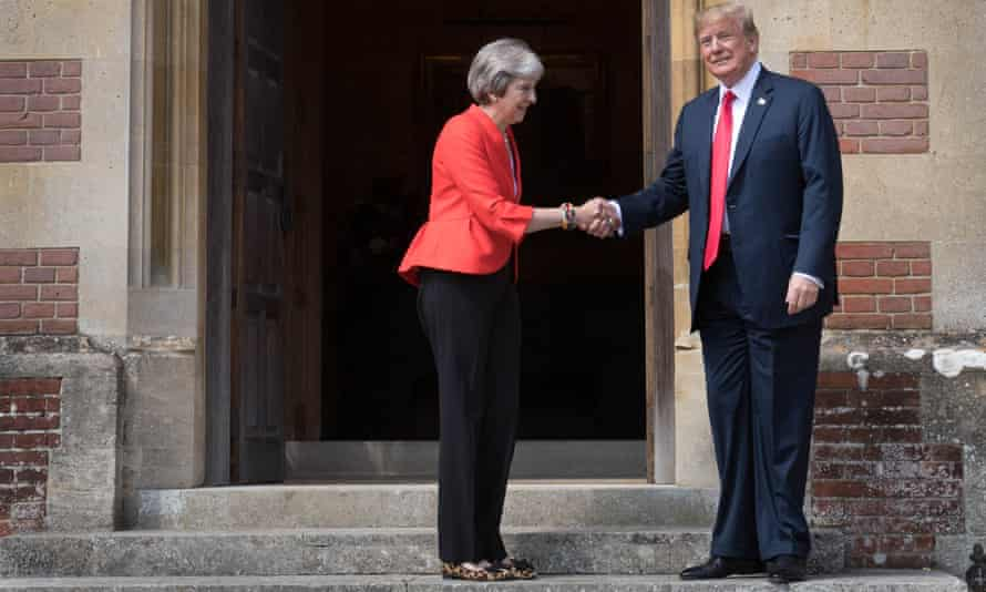 US President Donald Trump and Theresa May shake hands upon Trump's arrival for a meeting at Chequers.
