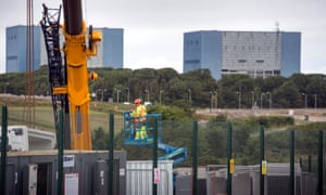 The Hinkley construction site near Bridgwater, with the twin reactors of Hinkley A in the background.