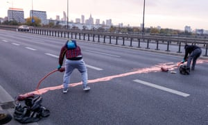 Protesters spill red paint on the Łazieńkowski Bridge