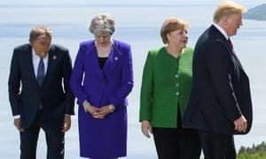 Donald Tusk, Theresa May, Angela Merkel and Donald Trump at the G7 summit in Canada