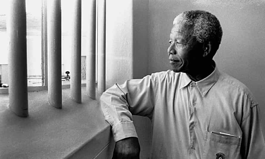 Nelson Mandela in his former cell at Robben Island.