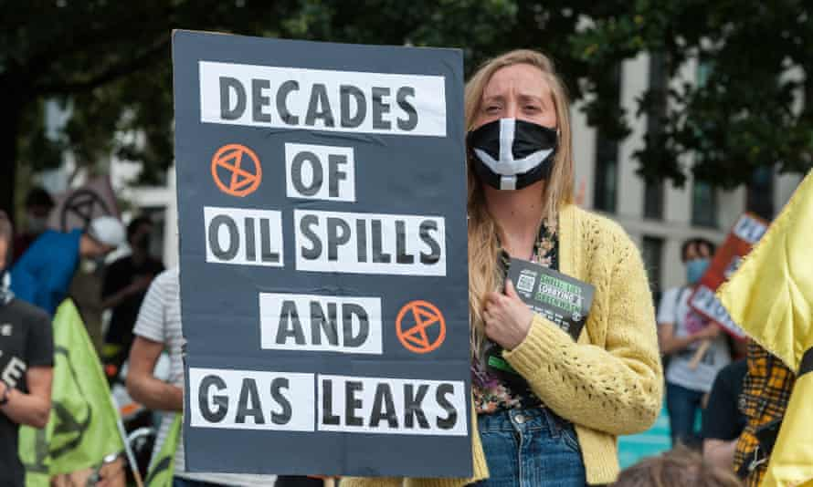 Activists from Extinction Rebellion stage a protest demanding an end to extraction of fossil fuels