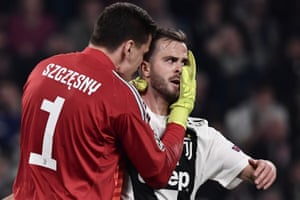 Szczesny congratulates Pjanic after he cleared from the line.