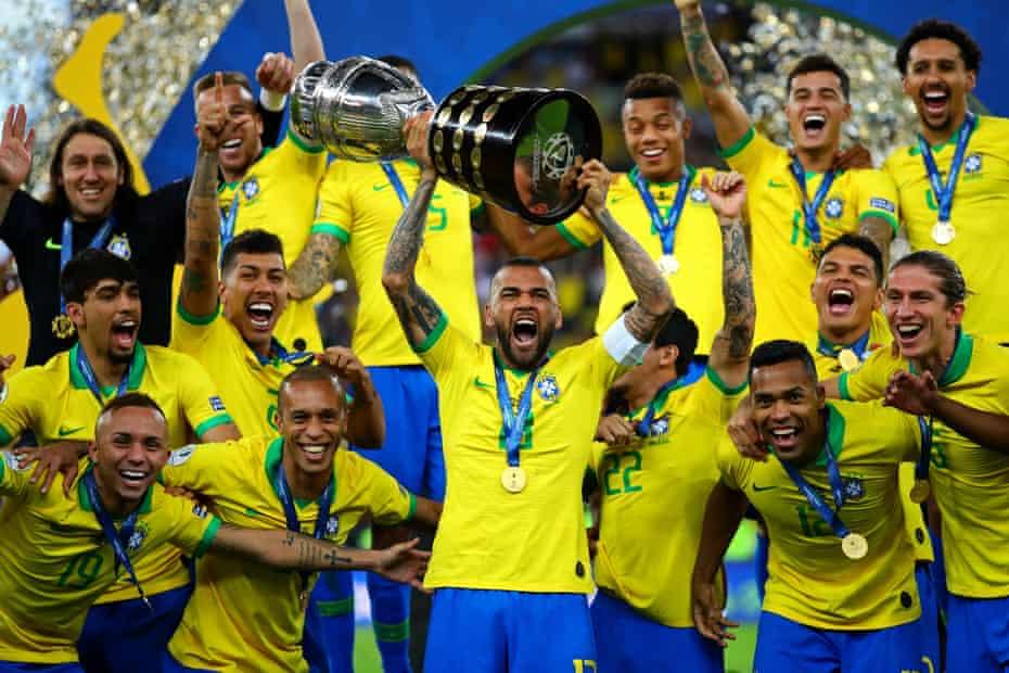 Dani Alves celebrates after winning the Copa América in 2019.
